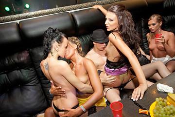 Wild girls fuck a stripper in the club